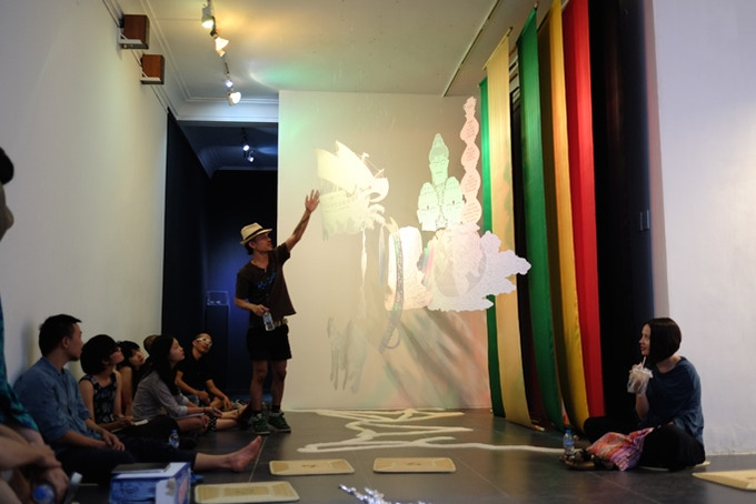 Artist Rudy Atjeh, San Art Laboratory Session 5, in the final group critic