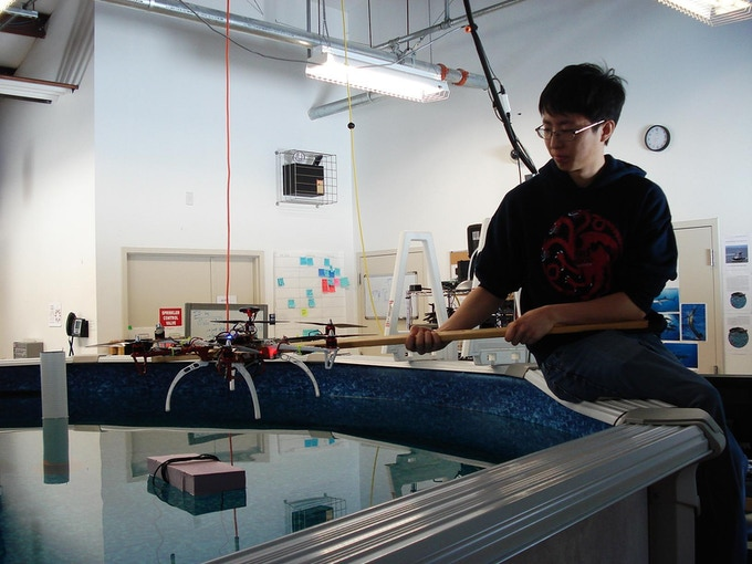 Here, Olin college student Jay captures audio output of a Snotbot over water.