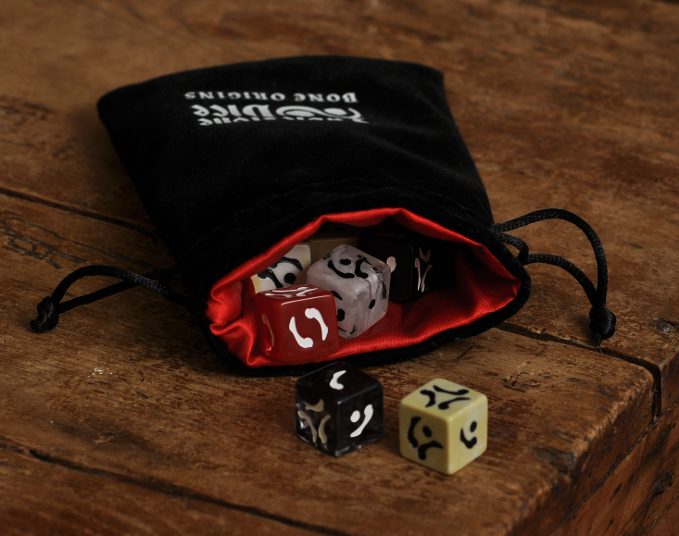 The dice in the Bone Origins velvet dice bag with a red satin lining.