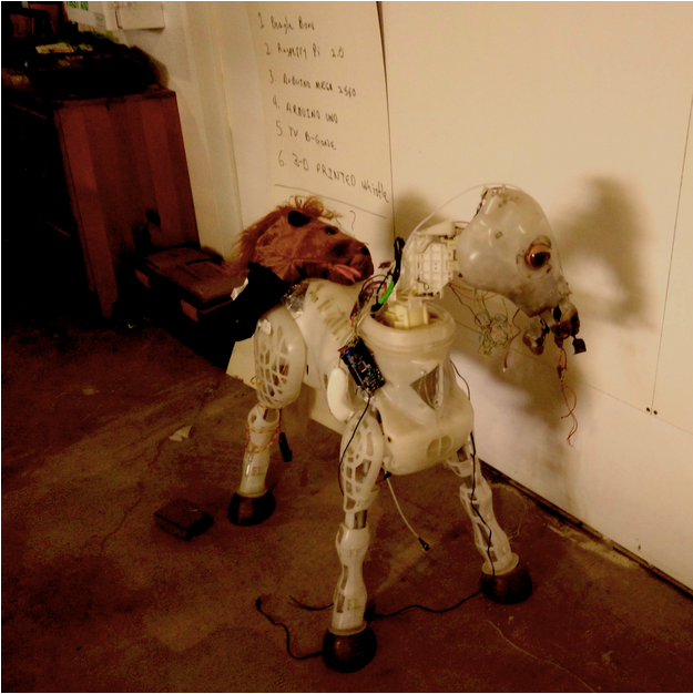 Fire-breathing animatronic pony, partially disassembled for pony maintenance