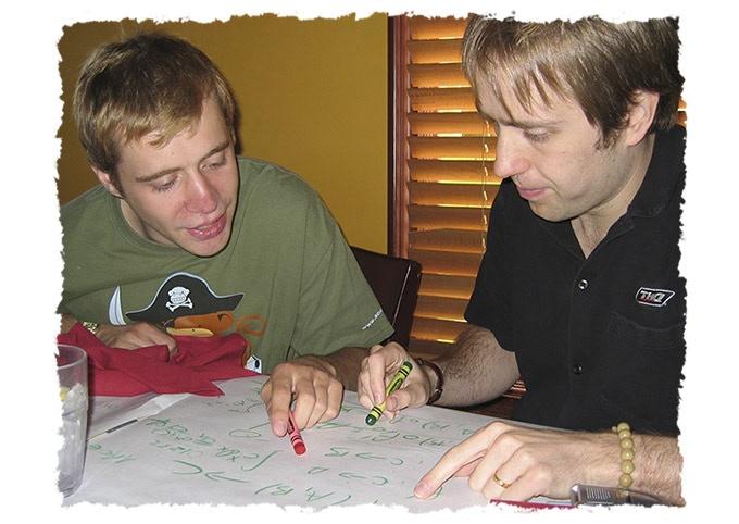 Matt and Dan solving Calc problems at dinner