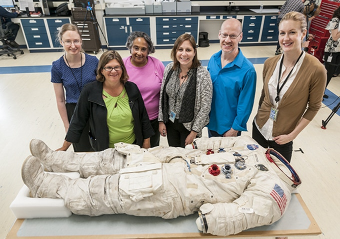 Some of the Smithsonian project team with Armstrong's suit.