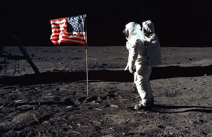 Astronaut Buzz Aldrin poses for a photograph beside the deployed United States flag during an Apollo 11 Extravehicular Activity (EVA) on the lunar surface. Astronaut Neil Armstrong, commander, took this picture with a 70mm Hasselblad lunar surface camera.
