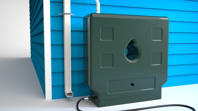 Simulated image of the Raindrop Box 50 linked to a downspout, with a hose connected at the bottom ready to nourish some plants!