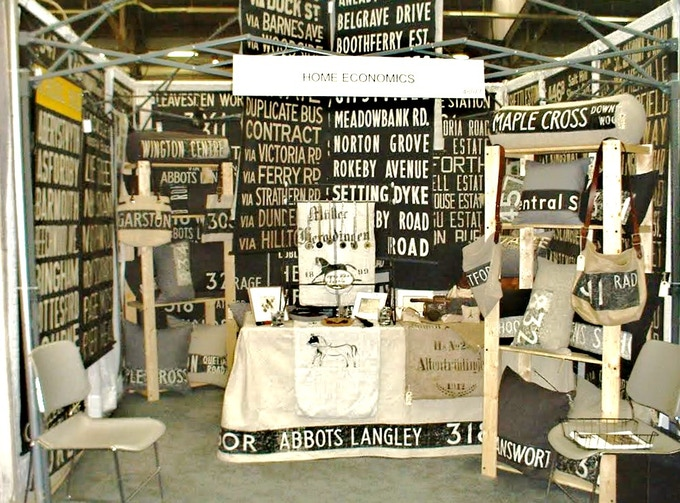 """My teeny tiny $5K booth - """"At Home"""" Pier Show - New York Gift Show - I flew into New York from Oregon carrying this entire display booth & inventory in black military surplus duffel bags!"""