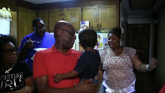 Grandson Ken Daniel holds his grandson