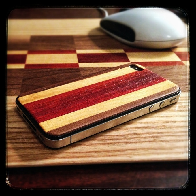The very first time we put wood on an iPhone... it just felt natural.  This phone is sitting on a mousepad we had just made prior, using wood leftover from making longboards.
