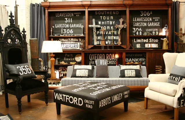 A room setting of Vintage British Route Sign merchandise at my Brick & Mortar Store in Grants Pass, OR