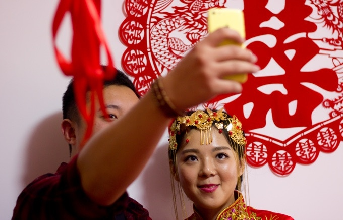 Min taking a selfie with another relative on her wedding day