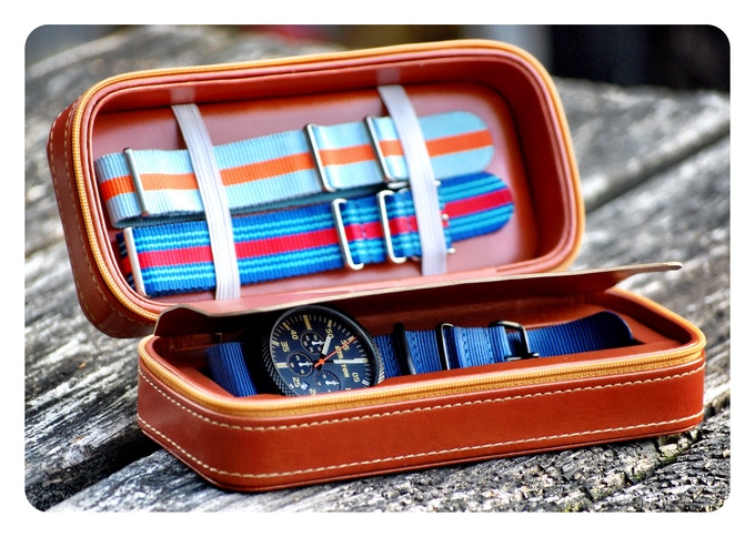 The complete package: 1 watch, 1 plain NATO strap, 2 racing inspired NATO straps and the leather carry case