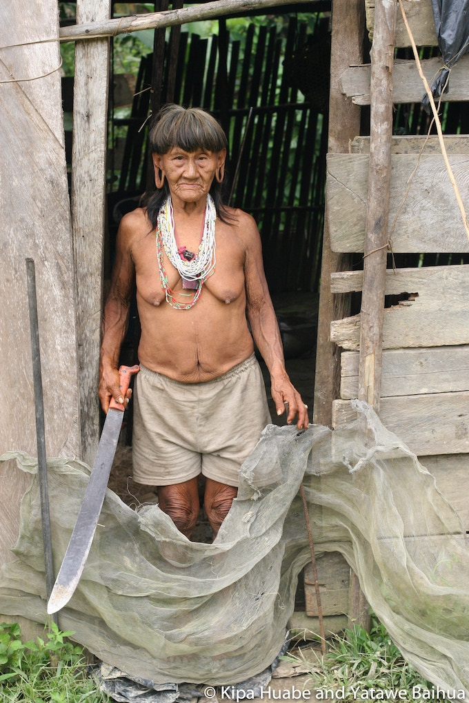 Meñemo in the doorway of her home in the Waorani community of Bameno on Cononaco River in Yasuní Biosphere Reserve.