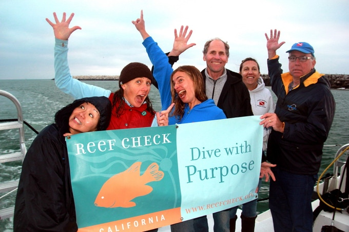 A  happy team of Reef Check divers celebrates their successes on a previous, and much smaller, survey trip to the islands.