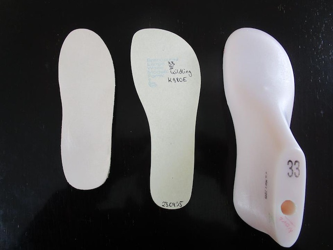 A regular insole (left) compared to the Wildling insole (center)