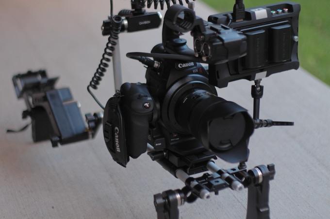 My Canon C100 cinema camera, shoulder rig, SmallHD monitor, and Atomos Ninja recorder.