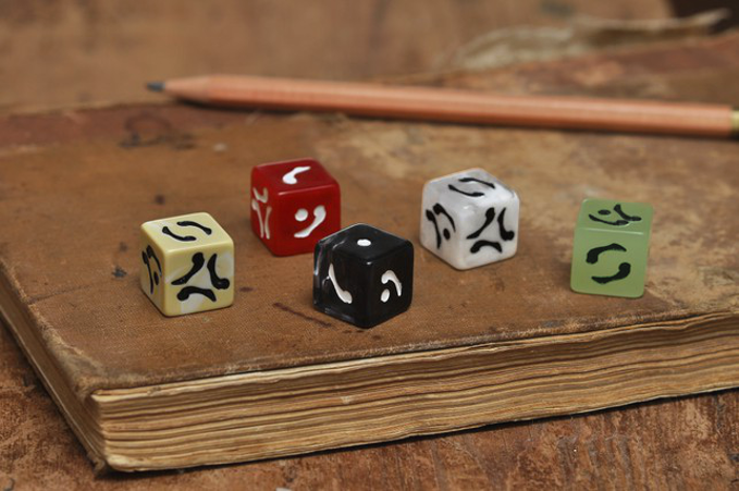 Fablestone Dice don't use any conventional numbers or pips. And look as though they could have been lifted from a fantasy setting.