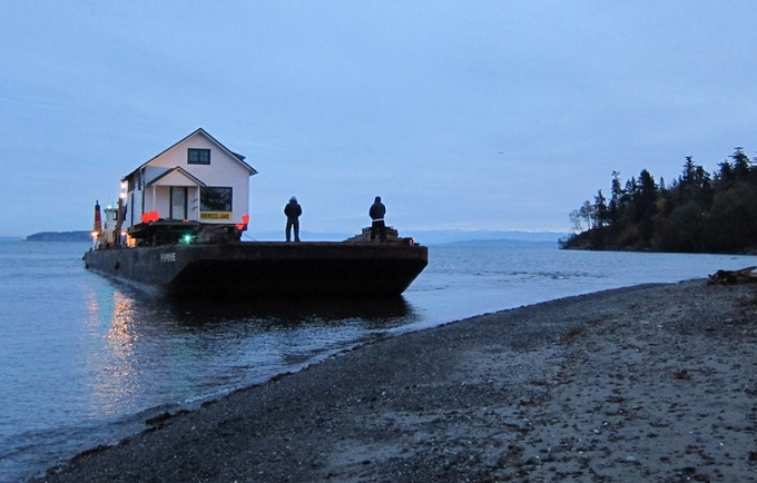 An OPAL house heads to Orcas Island by ocean-going barge.