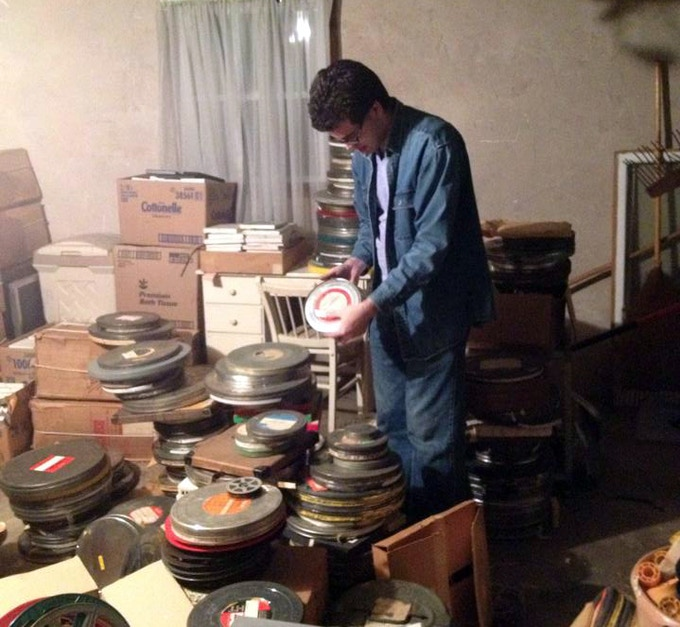 Tommy in action, rescuing old films before they are put in a dumpster. Photo by Dan Patterson.