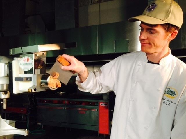 Jeff Gardner, the pasta gardner extruding pasta.