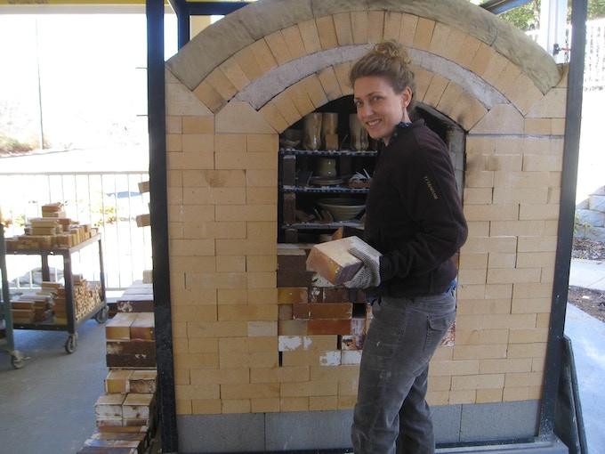 LeElaine and the kiln door.