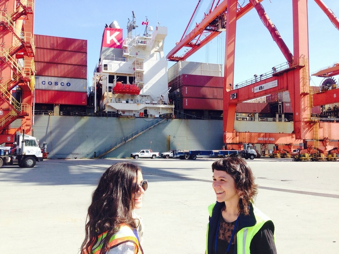 Our first two artists-in-residence, Nour Bishouty (left) and Elisa Ferrari, on the docks at the Port of Vancouver. Elisa has just returned from her residency voyage and Nour departs on August 4, 2015, the day this kickstarter campaign launches!