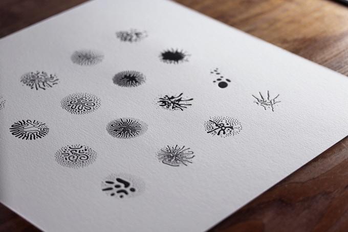 "12"" letterpress print, depicting 16 glyphs in a mixture of ferrofluid and Pantone Black printing ink."