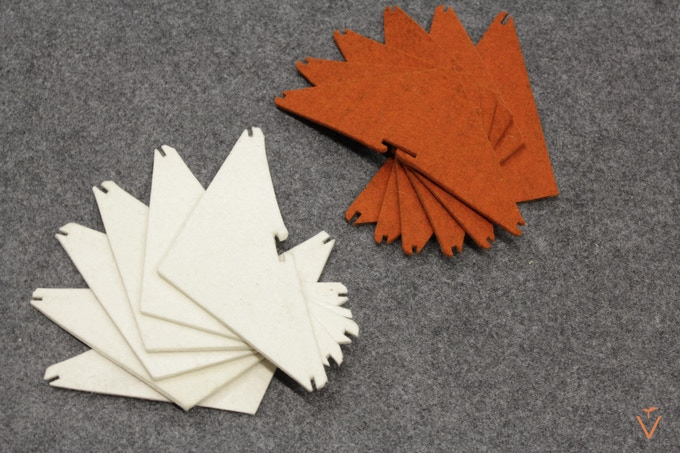 Vàs comes in charcoal grey with your choice of either ivory or burnt orange flaps.