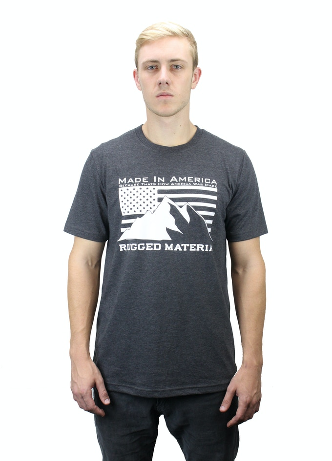 "The Patriot Tee. The text on the shirt reads ""Made in America, Because that's how America was made"""