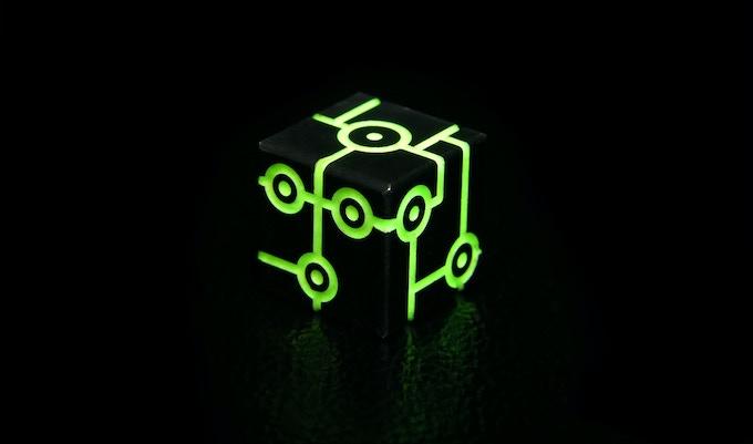 Black adonized with green glow in dark