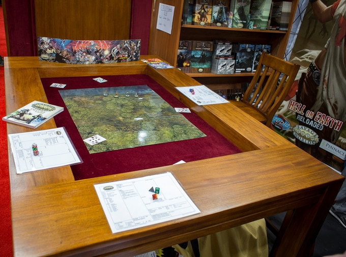 Deep enough to hold all your game materials, and you can even store them with the table top on!