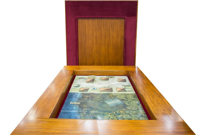 The Carolina Game Table holds TWO maps side by side! The underside of the table top is shown at the rear of the table.