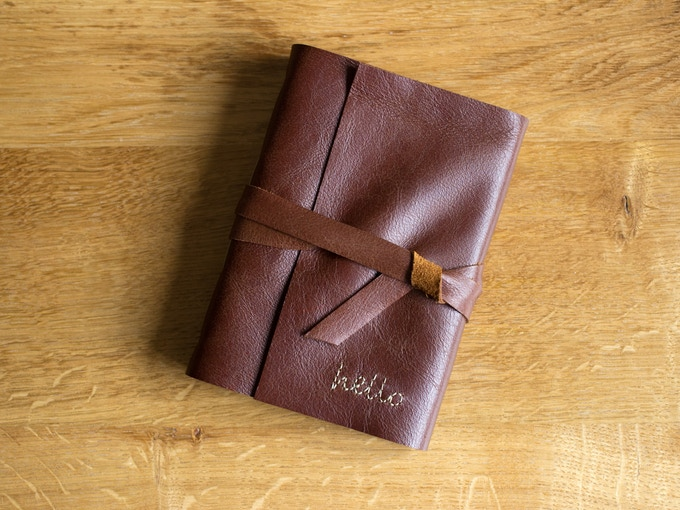 """A Beautiful, Handmade Journal (6 x 4) from the amazing Jackdaw Bindery. These are custom made with """"hello"""" embroidered on the front and """"goodbye"""" embroidered on the back. Photo credit Jackdaw Bindery"""