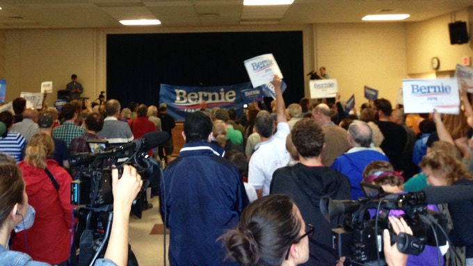 In the press section of a Bernie rally dreaming about becoming a real podcast