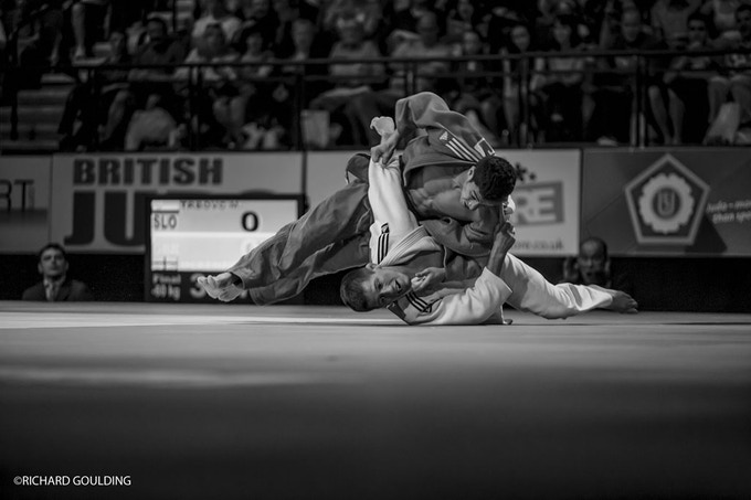 CONTEST: Ashley McKenzie throws Matjaz Trbovc (SLO) to win gold at the World Cup, Liverpool 2011, with Go Tsunoda coaching matside.