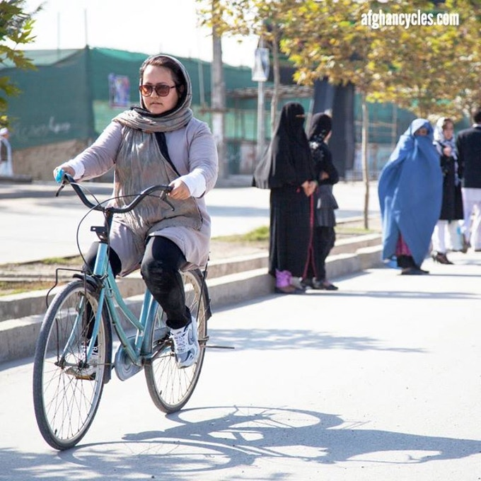 Young woman exuding confidence on Darulaman road in Kabul, Afghanistan. She's out for a morning ride with friends. Photo: Afghan Cycles/Jenny Nichols