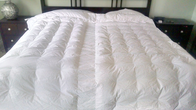 AirComforter fully inflated, you will lay your normal bedding on top of it (quilts, blankets, comforters, etc)
