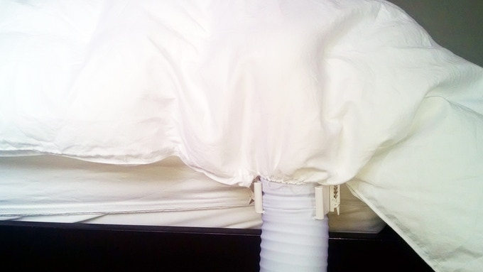 BedJet air nozzle plugs right into the AirComforter! One port on each side of the bed at the bottom of the bed