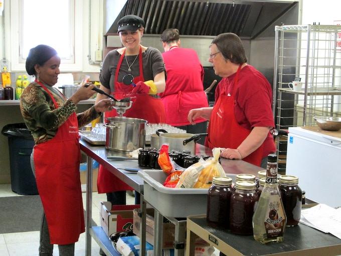 Carol and the team creating something yummy!
