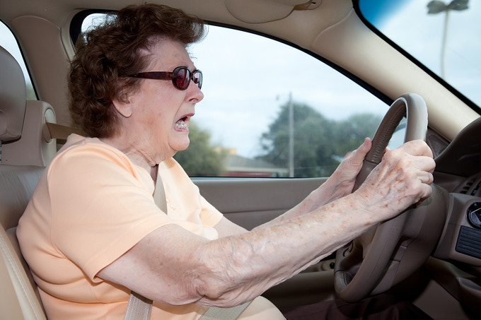 Title: Elderly woman getting into car accident