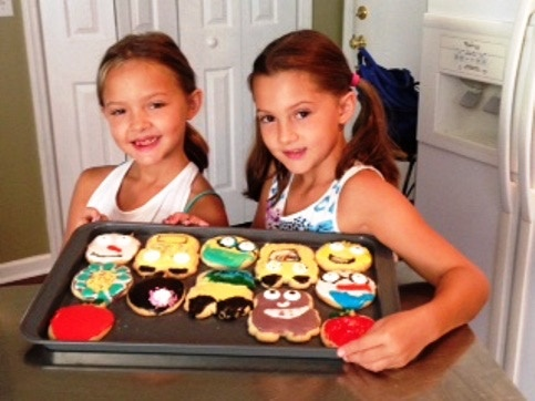 Pictured are a couple of young cookie decorators putting on the finishing touches to back to school cookies they decorated this weekend!