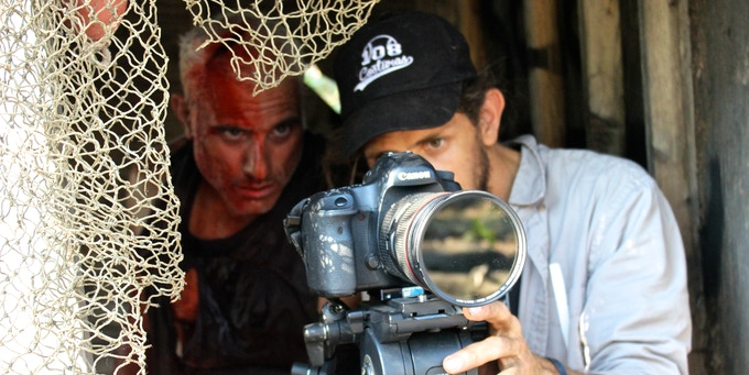 Felipe on the trailer shoot; Sandy (in character) to his left.