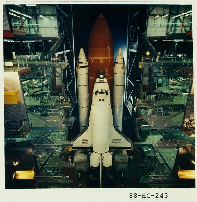 July 4, 1988. KENNEDY SPACE CENTER, Fla — The Space Shuttle Discovery is rolled out to pad 39-B as preparations for STS-26 continue. Image: NASA.