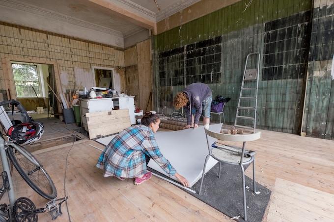 Sashana and Ben working on the studio
