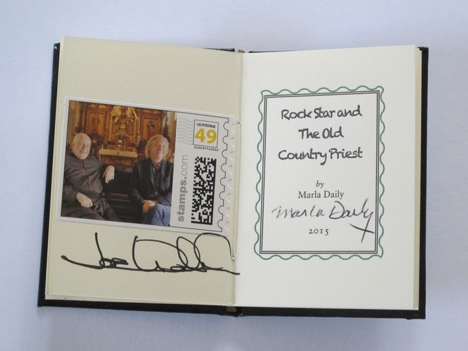 "$3,000 Reward: A Limited Edition Miniature Book (3""x2""), 10 pages, signed by Monsignor Weber and musician Joe Walsh. A JW guitar pick is part of the inside front cover."