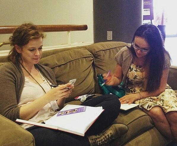 Leah and Teresa, hard at work budget planning!