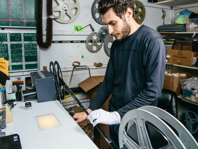 Head archivist Sebastian del Castillo inspects a print at AGFA HQ.
