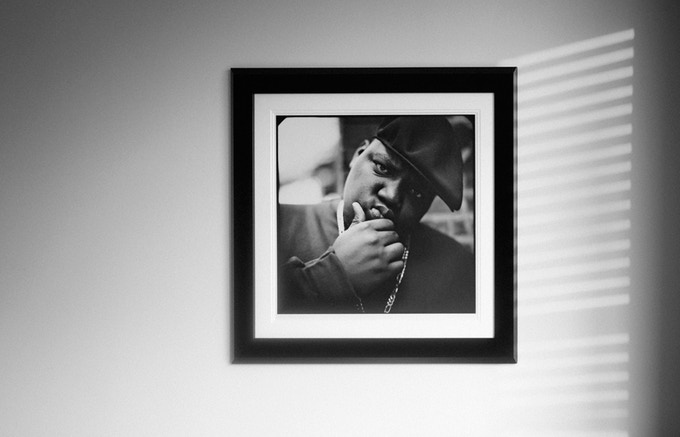 The sun sets on a framed Biggie Smalls print.