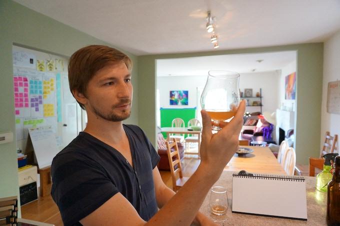 fermentation specialist Thomas Weaver checking for quality