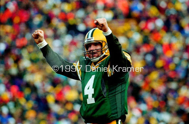 Brett Favre raises his arms after throwing a TD in the NFC Divisional Playoff game against the San Francisco 49ers.