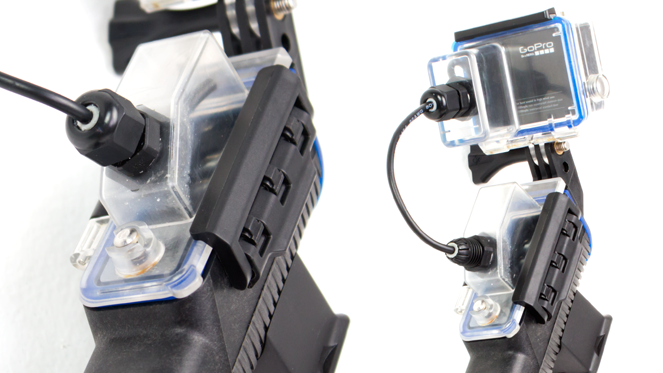 Included with the Live Charge Kit; a custom GoPro waterproof backdoor as well as a PowerGrip backdoor, allowing charging at depths of up to 99 feet.