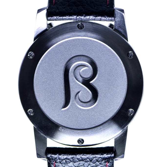 The watch's caseback features the B&S logo